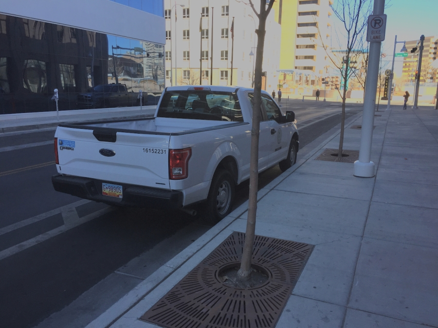 Albuquerque city planning department pickup, parked in a bike lane next to a